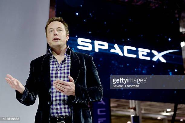 SpaceX CEO Elon Musk unveils the company's new manned spacecraft The Dragon V2 designed to carry astronauts into space during a news conference on...