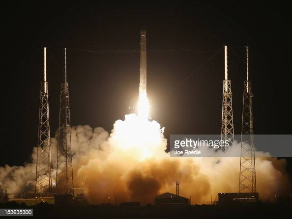 SpaceX Falcon 9 rocket attached to the cargoonly capsule called Dragon lifts off from the launch pad on October 7 2012 in Cape Canaveral Florida The...