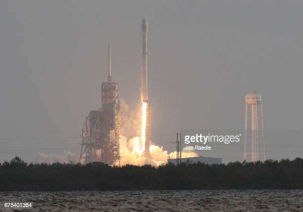 SpaceX Falcon 9 rocket launches from pad 39A on May 1 2017 in Cape Canaveral Florida The rocket is delivering a classified payload to orbit for the...