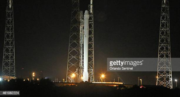 A SpaceX Falcon 9 rocket poised on Launch Pad 40 in Cape Canaveral Fla on Monday Jan 5 will launch the Dragon spacecraft early Tuesday to deliver...