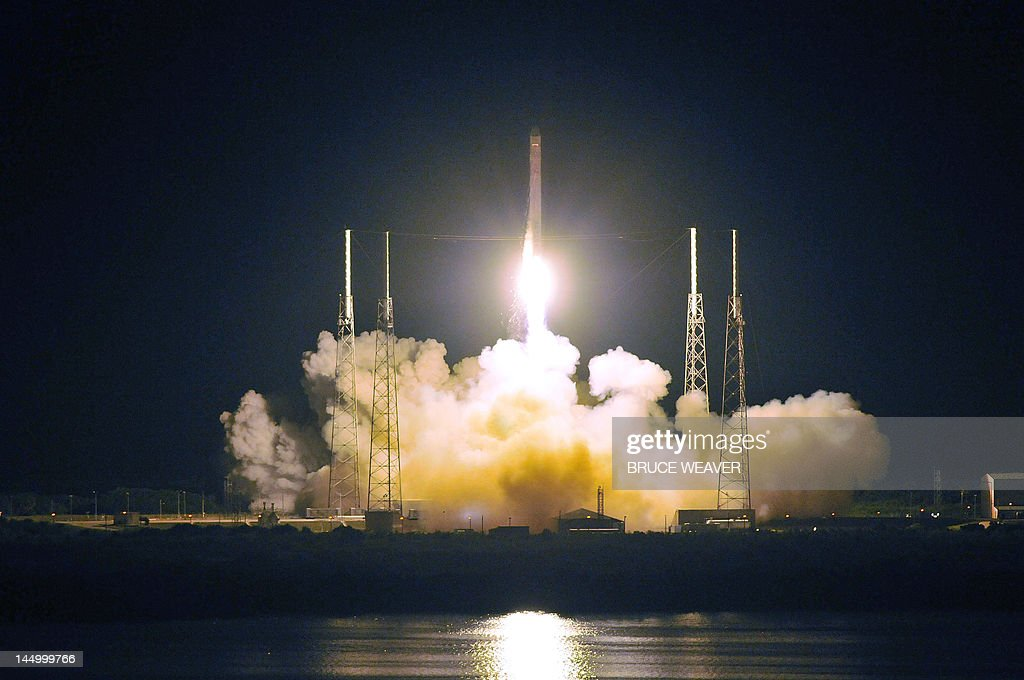 SpaceX's Falcon 9 rocket early May 22 2012 as it heads for space carrying the company's Dragon spacecraft from pad 40 at Cape Canaveral Florida The...