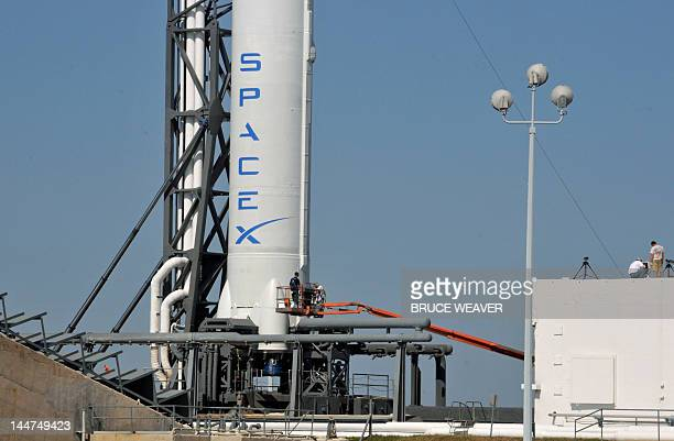 SpaceX's Falcon 9 spacecraft with the Dragon reusable capsule sits on the launch pad on May 18 2012 in Cape Canaveral Florida The rocket is being...