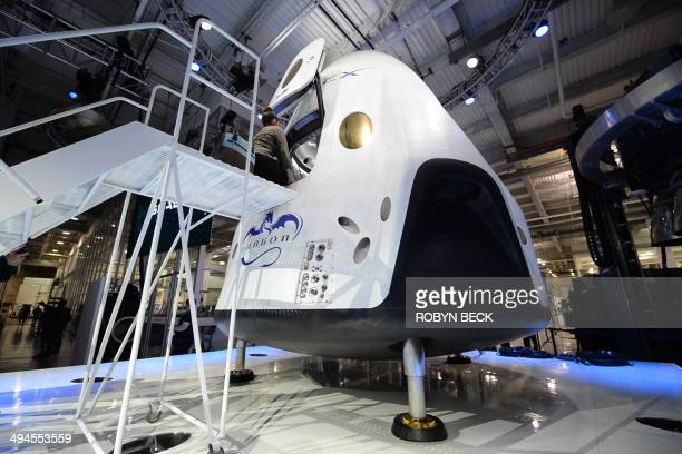SpaceX's new sevenseat Dragon V2 spacecraft is seen at a press conference to unveil the new spaceship in Hawthorne California May 29 2014 The private...