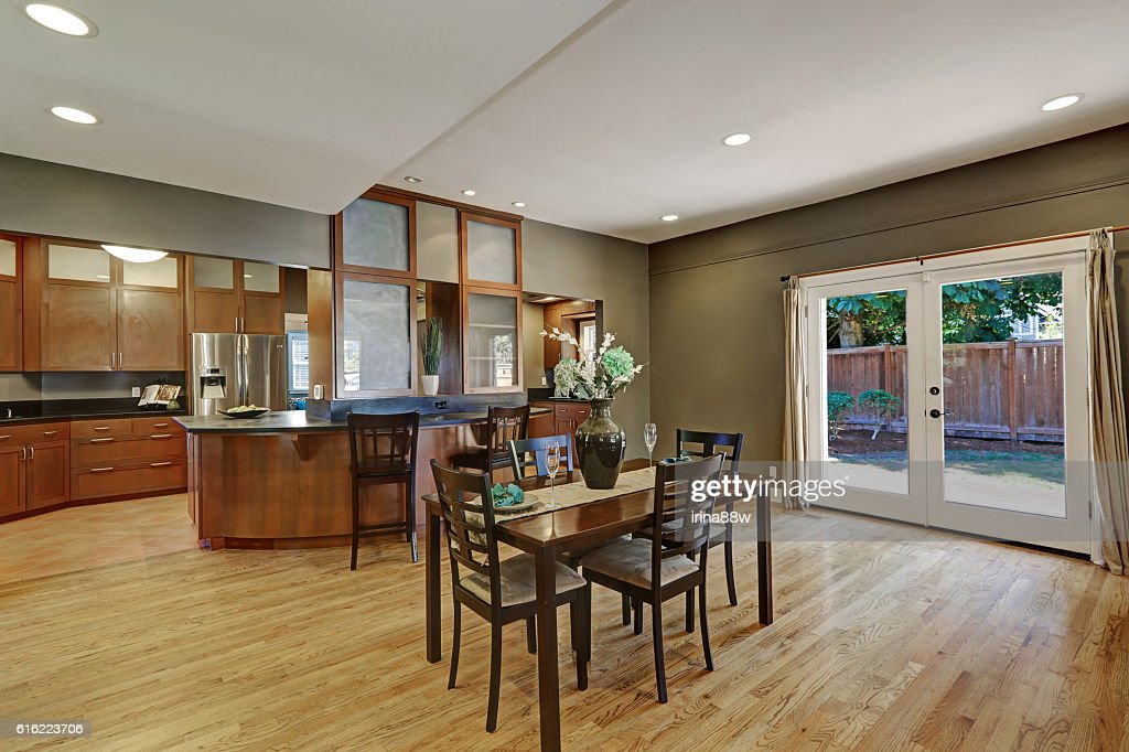 Spacious dining room with hardwood floor and exit to backyard : Stock Photo