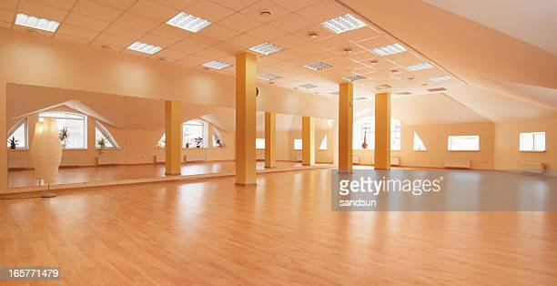 Spacious empty yoga class with natural sky light