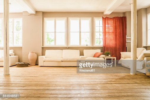 Spacious living room with wooden floor