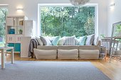 Image of spacious place for relax with big sofa