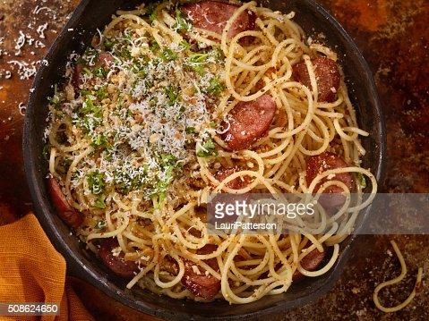 Spaghetti Aglio e Olio With Sausage and Parmesan : Stock Photo