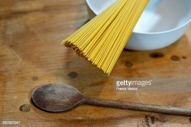 Spaghetti and wooden spoon