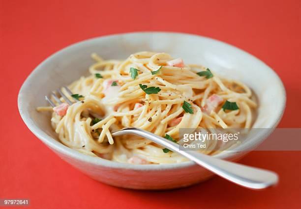 Spaghetti Cabonara in Bowl with Fork & Pepper