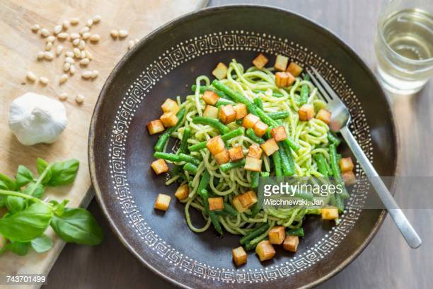 Spaghetti genovese with cedar nut pesto, beans and diced potatoes