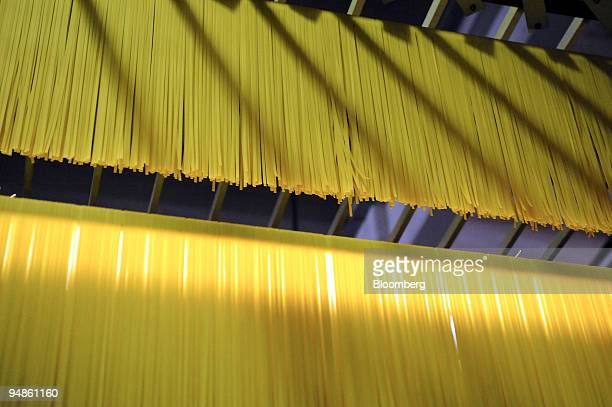 Spaghetti is made along the production line at the Delverde pasta factory in Fara San Martino Italy on Wednesday April 9 2008 The World Bank says 33...