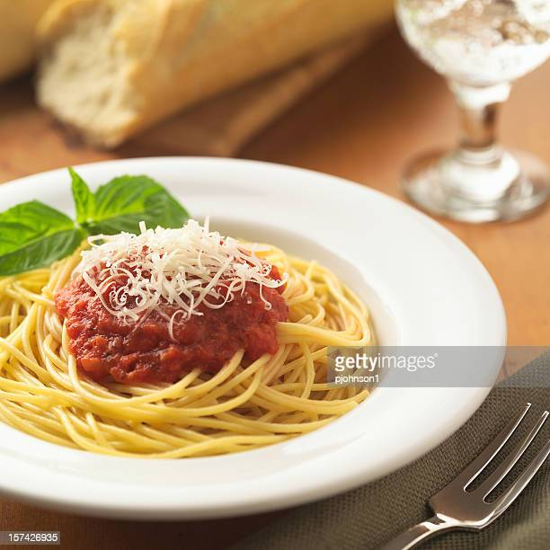Spaghetti marinara with cheese.