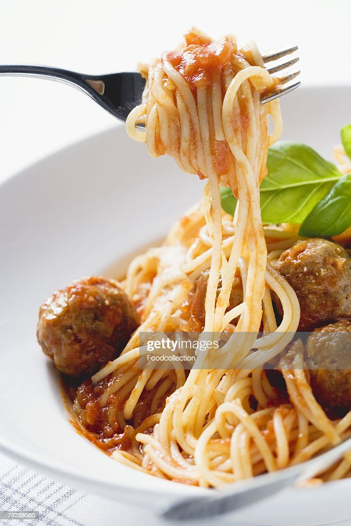 Spaghetti on fork with meatballs and tomato sauce : Stock Photo