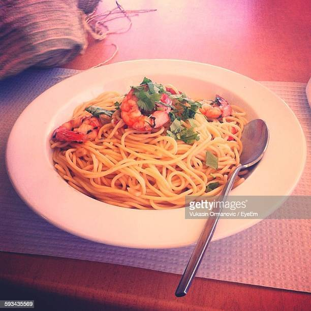 Spaghetti Served In Plate On Table
