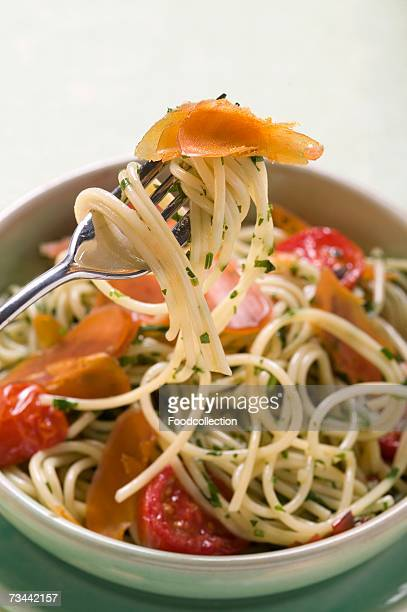 Spaghetti with bresaola and tomatoes