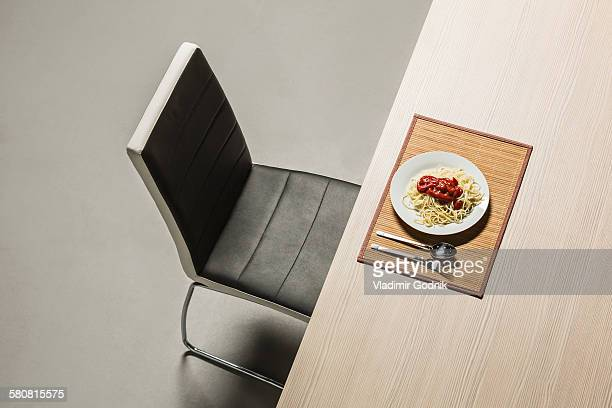 Spaghetti with fresh tomato sauce served in plate on table