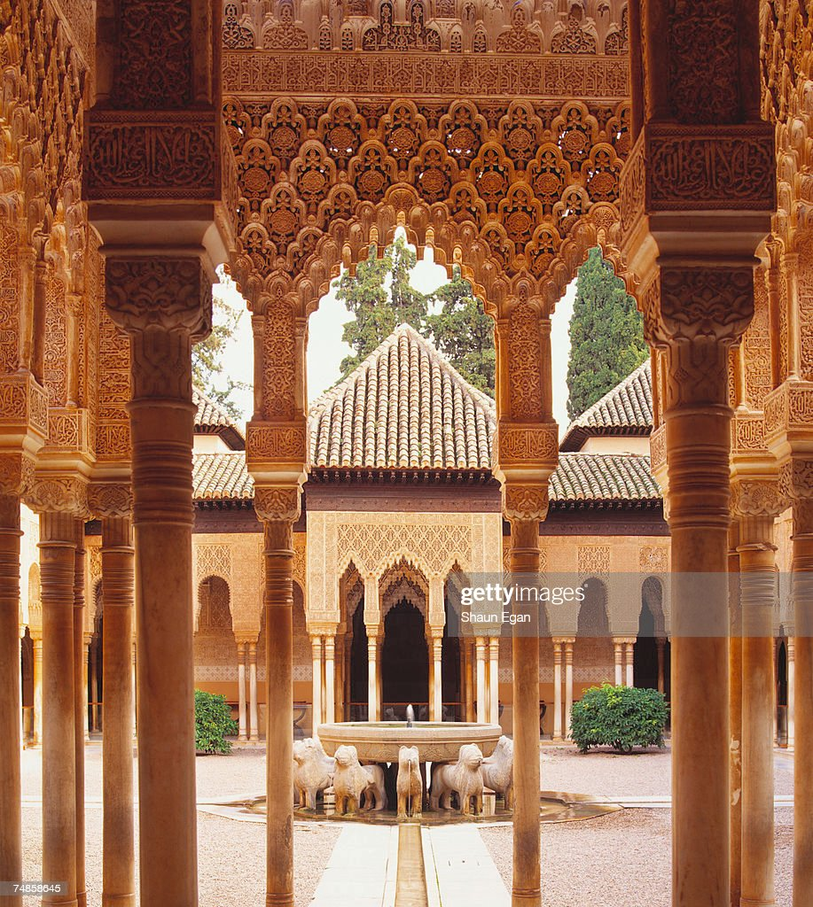 Spain, Analucia, Granada, Alhambra Palace, traditional courtyard framed by carvings