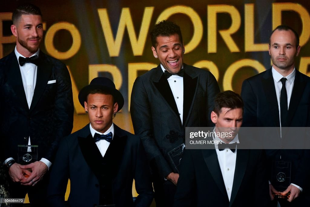 TOPSHOT - (From L) Spain and Real Madrid defender Sergio Ramos, Brazil and FC Barcelona forward Neymar, Brazil and FC Barcelona defender Dani Alves, Argentina and FC Barcelona forward Lionel Messi and Spain and FC Barcelona midfielder Andres Iniesta pose on stage after being selected in the 2015 FIFA FIFPro World XI during the 2015 FIFA Ballon d'Or award ceremony at the Kongresshaus in Zurich on January 11, 2016.