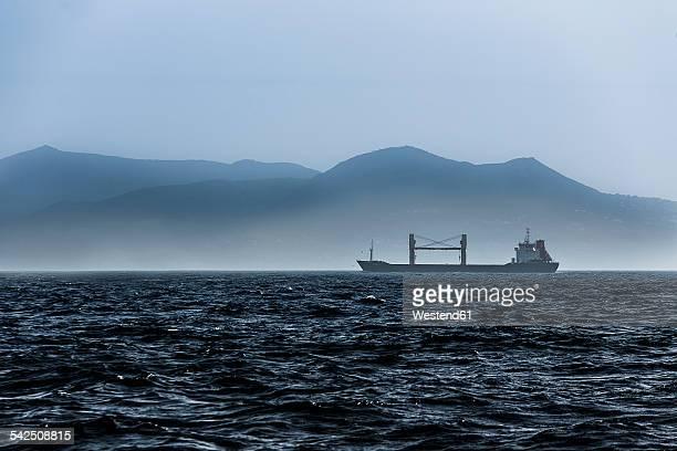 Spain, Andalucia, cargo ship at Moroccan coast