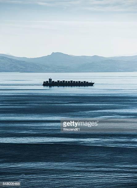 Spain, Andalucia, Tarifa, cargo ship at Moroccan coast