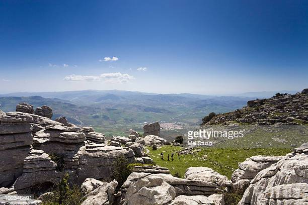Spain, Andalusia, El Torcal, Hikers in landscape