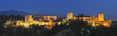 Spain, Andalusia, Granada Province, View of Alhambra Palace illuminated at dusk