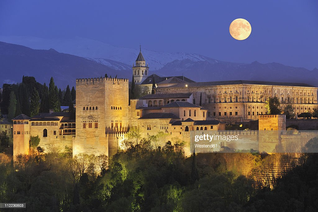 Spain, Andalusia, Granada Province, View of Alhambra Palace illuminated at night