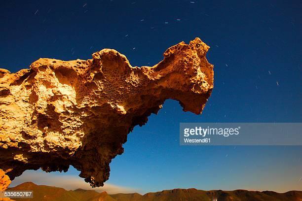 Spain, Andalusia, Natural Park of Cabo de Gata-Nijar, starry sky over rock spur