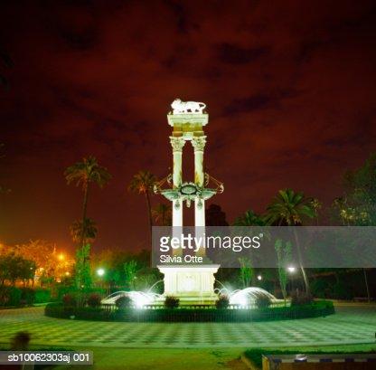 Spain, Andalusia, Sevilla, Lion fountain in park, night : Stock Photo