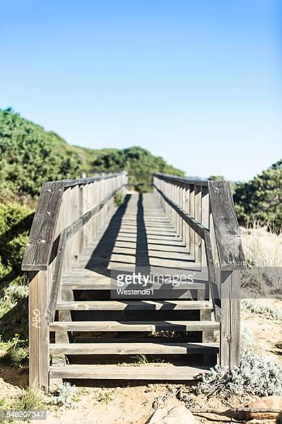Spain, Andalusia, Tarifa, Stairs of wooden footbridge
