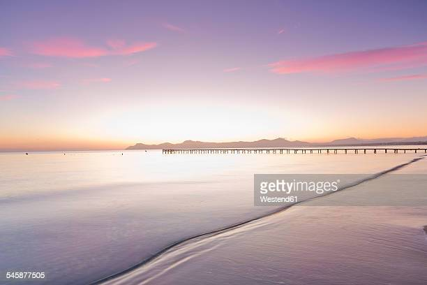 Spain, Balearic Islands, Majorca, footbridge leads out to the sea in the morning light