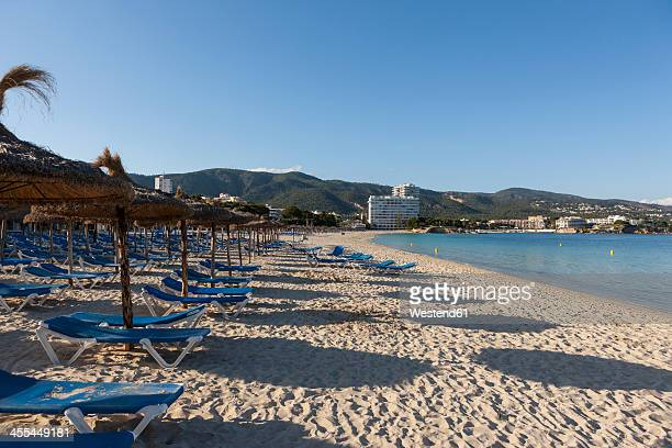 Spain, Balearic Islands, Mallorca, Palma, View of Palmanova with sun loungers and hotels