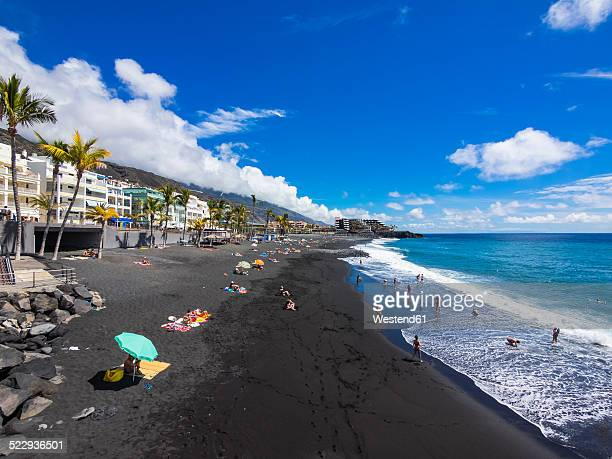 Spain, Balearic Islands, Puerto Naos, Tourists on the black lava beach