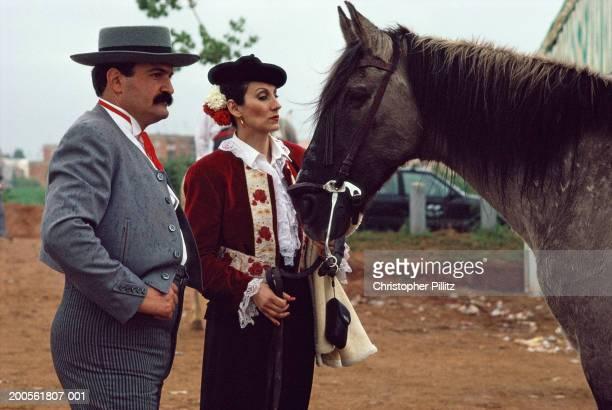 Spain, Barcelona, April Fair, matador couple with horse