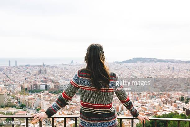 Spain, Barcelona, back view of woman looking at view from Turo de la Rovira