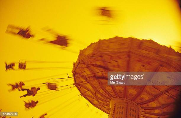 Spain, Barcelona, Roundabout, Carousel, low angle view (blurred motion)