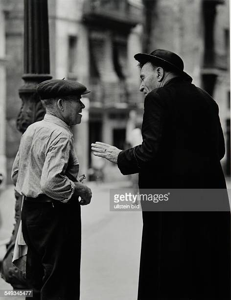 Spain Barcelona catholic priest talking with old man in the street