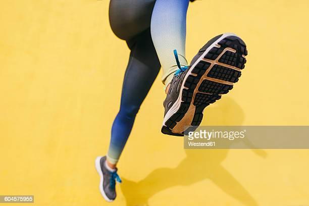 Spain, Barcelona, jogging woman, sole of shoe