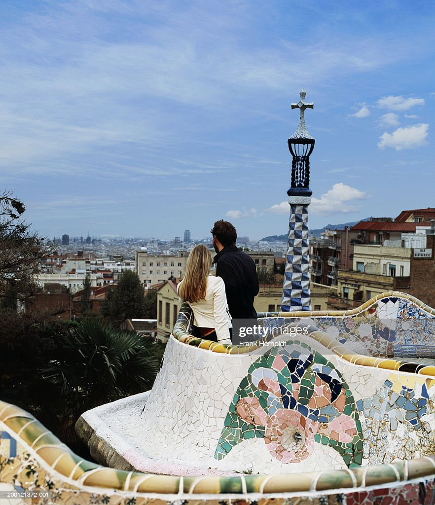 Spain, Barcelona, Parc Guell, young couple looking at view of city : Stock Photo