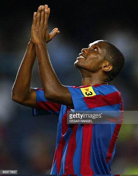 Barcelona's Samuel Eto'o raises his arms to the sky during their Spanish League soccer match against Mallorca in Barcelona 11 September 2005...