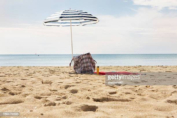 Spain, Beach umbrella and towel at Palma de Mallorca