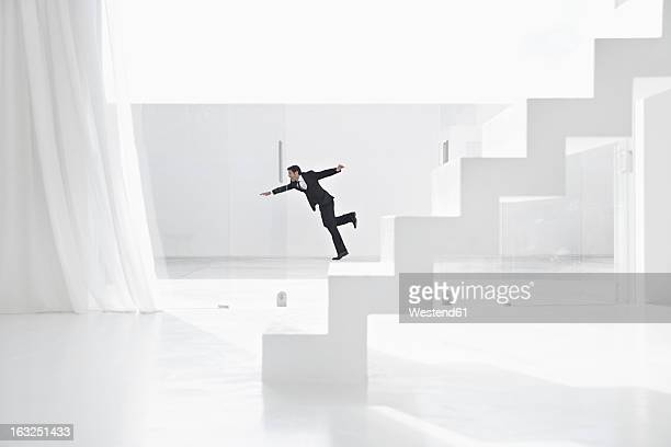 Spain, Businessman falling down from ladders