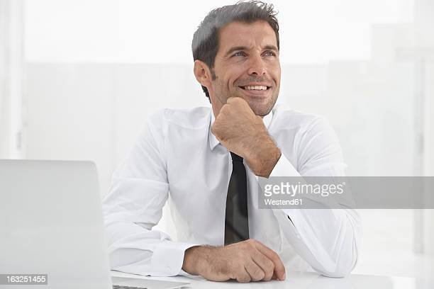 Spain, Businessman thinking, smiling