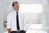 Spain, Businessman thinking, smiling