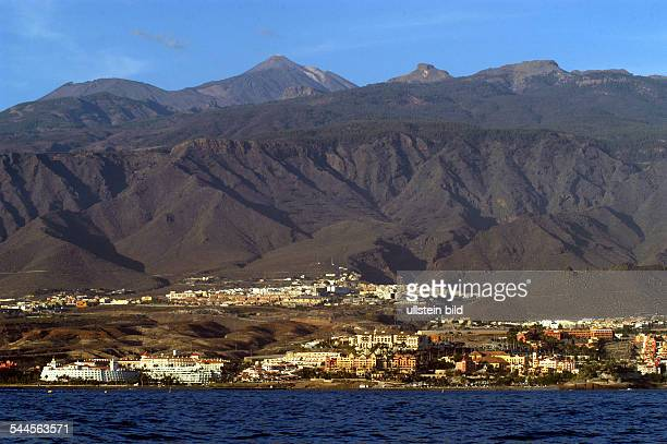 Spain Canary Islands Canaries Teneriffa coastline at Adeje mountain chain with volcano Teide in the background