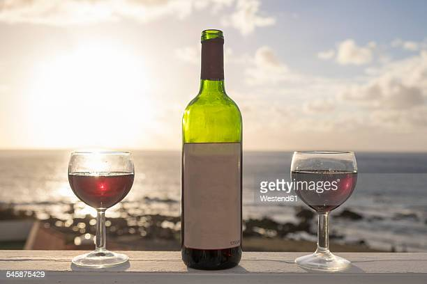 Spain, Canary Islands, La Gomera, two glasses of red wine and wine bottle