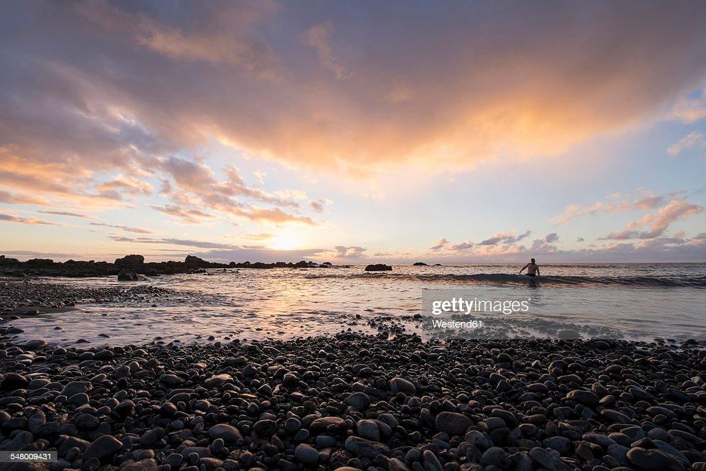 Spain, Canary Islands, La Gomera, Valle Gran Rey, evening at shingle beach