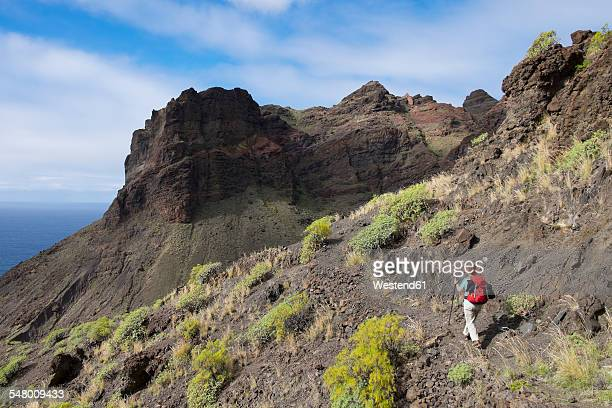 Spain, Canary Islands, La Gomera, Valle Gran Rey, Risco de Tejeleche, Barranco de Guaranel near Taguluche, hiker