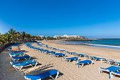 Spain, Canary Islands, Lanzarote, Costa Teguise, Beach Baja de los Charcos, Hotel Las Salinas in the background